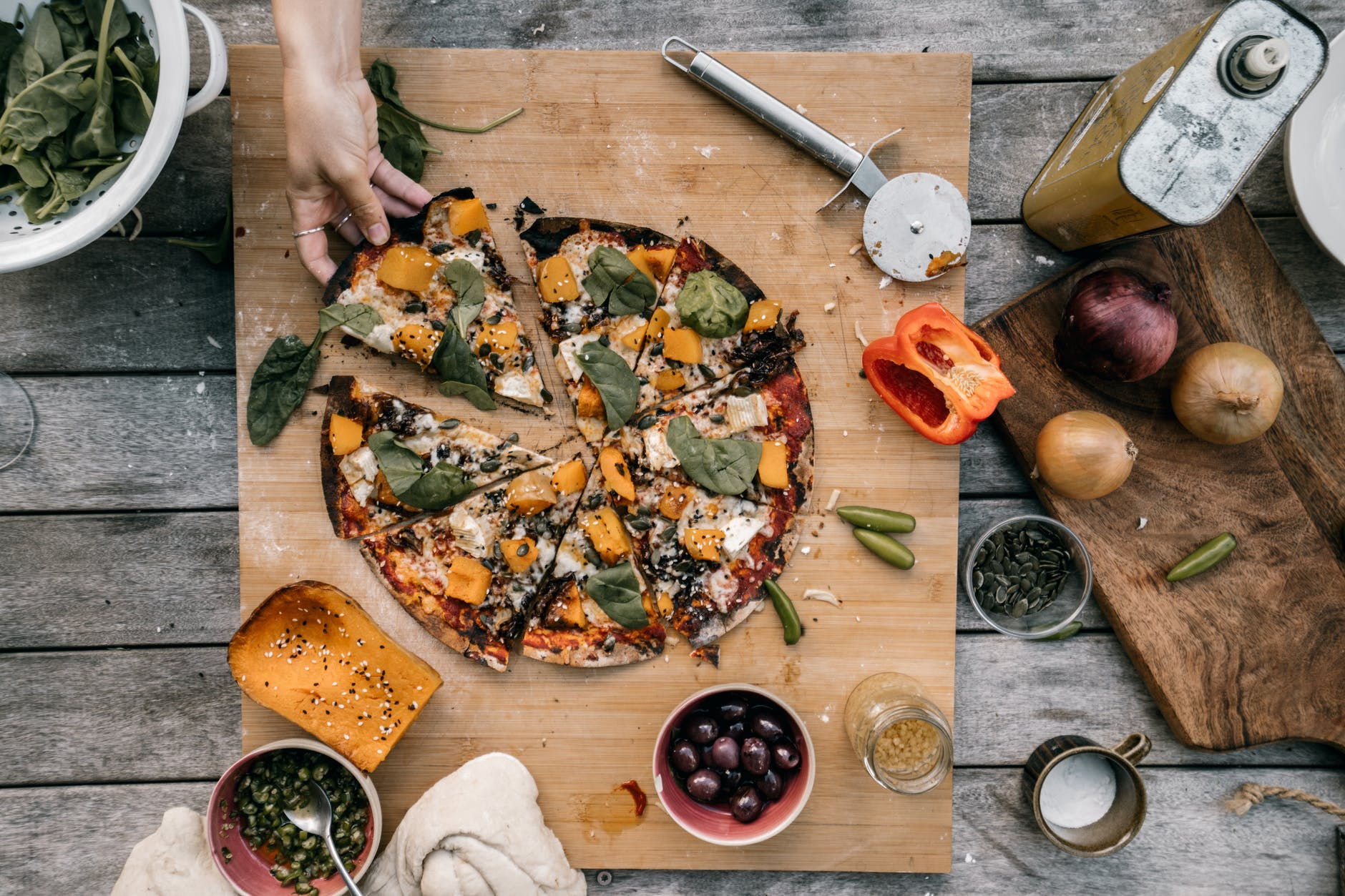 close up shot of vegetable pizza on a wooden surface